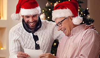Asking a person who is memory impaired to tell stories from bygone holidays may help trigger a happy memory. Photo courtesy Lucky Business/Shutterstock.com