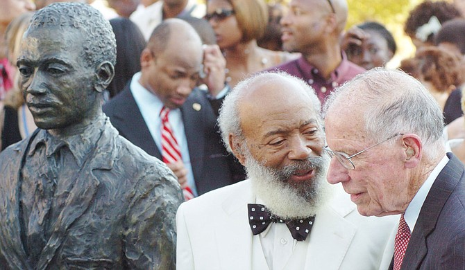 Jackson Free Press Editor Donna Ladd recounts the influence two remarkable men—James Meredith (left next to his University of Mississippi statue) and Gov. William Winter (right) have had on her life and this newspaper. Photo by Bruce Newman/Oxford Eagle via AP
