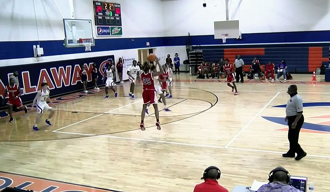 The Forest Hill Patriots, in red, battle with Madison Central Jaguars on Dec. 28, 2020, in a basketball game at Callaway High School's gymnasium. Screenshot courtesy The Geeker Report Podcast