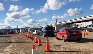 The Mississippi Department of Health has a number of free COVID-19 testing options, including this drive-thru one at the West Street Farmers Market. Photo by Kristin  Brenemen