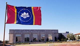 "Mississippi legislators are beginning their 2021 session Tuesday and one of their first tasks will be to finish adopting a new state flag that voters approved, with a magnolia blossom and the phrase, ""In God We Trust."" Photo courtesy MDAH"