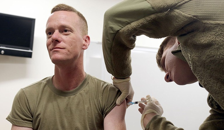 A Jackson National Guardsman receives his vaccination. Guardsmen can help fill roles in vaccine administration, and the State encourages vaccinations for Guard members. Photo by Sgt. Scott Tynes/U.S. Army National Guard