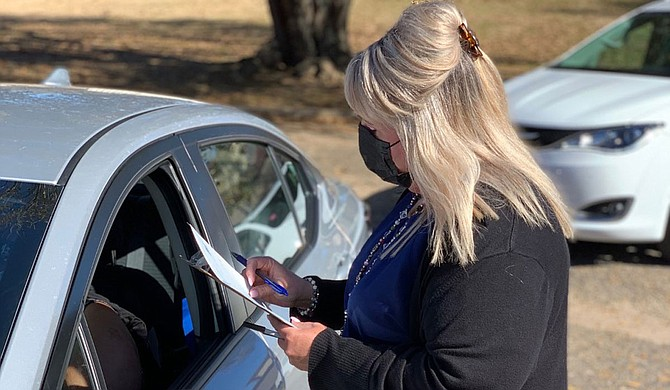 A line of cars waits at one of the drive-thru clinics available throughout the state. Vaccinations are free, and Mississippians can make appointments online or by phone. Photo courtesy Mississippi Department of Health