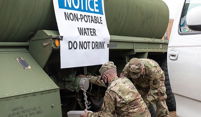Water for flushing toilets was being distributed at seven sites in Mississippi's capital city—more than 10 days after winter storms wreaked havoc on the city's water system. Army National Guard Photo by Sgt. Jovi Prevot