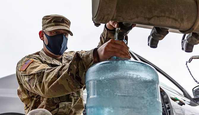 As March arrived, Mississippi National Guard members were supplying nonpotable water to Jackson residents. U.S. Army National Guard Photo by Sgt. Jovi Prevot