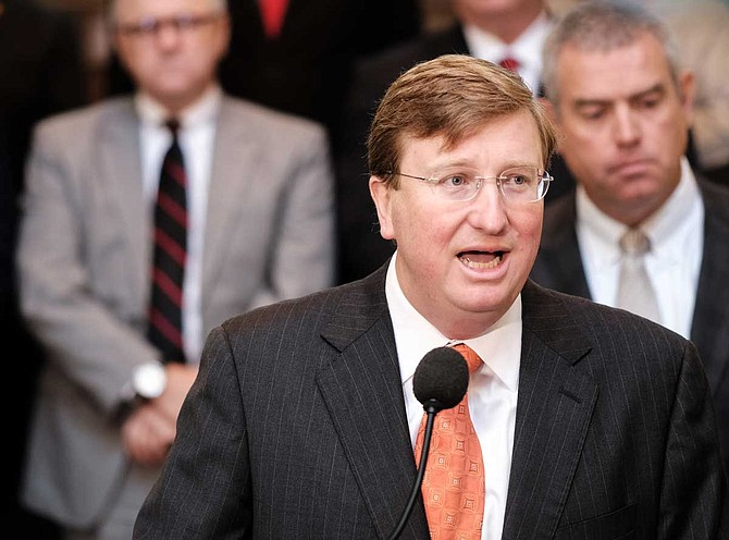Mississippi Gov. Tate Reeves on Monday signed a bill authorizing a $1,000 pay raise for most teachers, and lawmakers worked to adopt final parts of state spending and borrowing plans for the year that begins July 1. Photo by Ashton Pittman