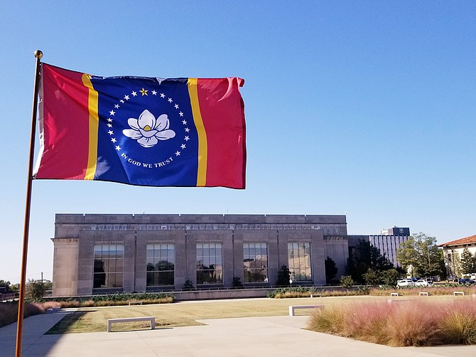 The first bill legislators passed and the governor signed this year has had an easy-to-see impact. House Bill 1 put the design of the new magnolia-themed state flag into law. Photo courtesy MDAH
