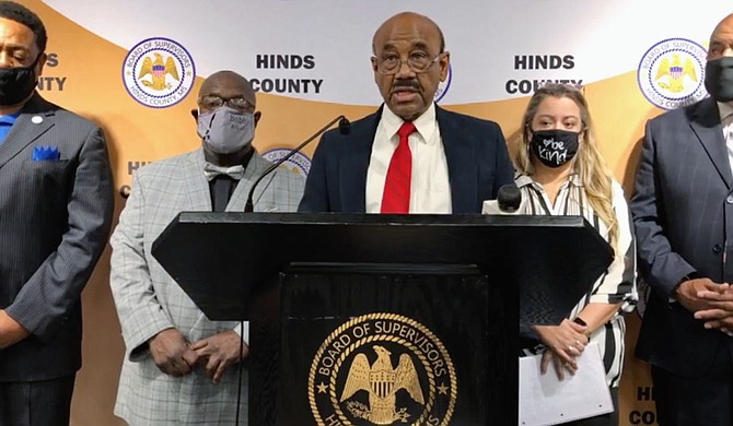 Hinds County Board of Supervisors President and District 3 Supervisor Credell Calhoun in a video posted on facebook announced emergency rental assistance for renters in the county at a press briefing on Tuesday, April 20. Also pictured, left to right: District 5 Supervisor Bobby McGowan, Program Manager Lauren Scott and Board of Supervisors Vice President and David Archie of District 2. Photo courtesy Hinds County.