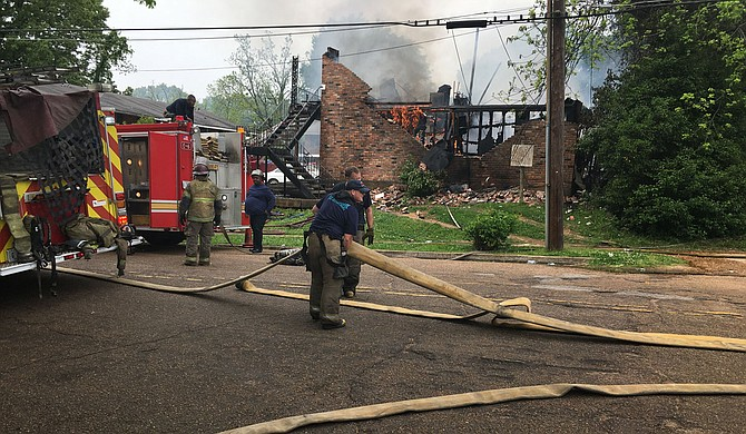 Firefighters were still on the job at an apartment complex on O'Ferrell Avenue, Jackson, as seen in this picture taken at 12:30 p.m. on Friday, April 16, 2021. Assistant Fire Chief Patrick Armon said the fire started at 10 a.m. Photo by Kayode Crown