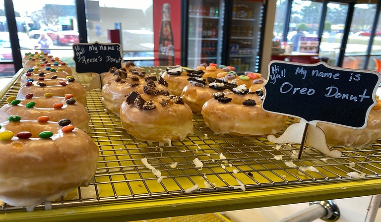 In addition to fresh-baked donuts all day, A'HA offers items such as wagyu or surf and turf burgers, extreme A'HA chicken biscuits and gravy, po-boys, hot wings, Philly cheese steak, chicken sandwiches, fried rice with chicken, beef or shrimp, weekly rotating breakfast specials and more. Photo courtesy A'HA Donuts & More