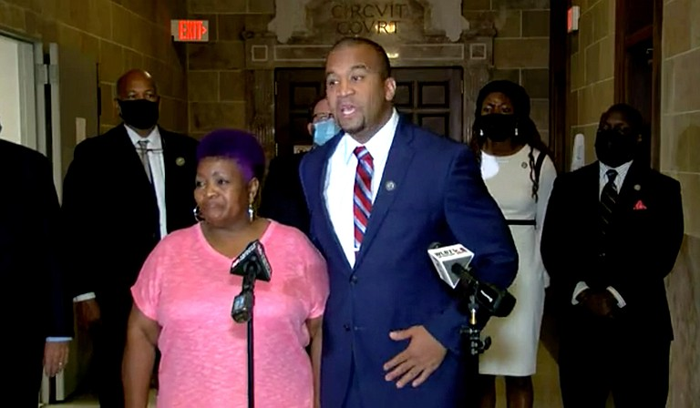 District Attorney Jody Owens (right) with George Robinson's sister Bettersten Wade at a media briefing on Thursday, May 20, after Judge Faye Peterson dismissed the murder case against two police officers indicted for Robinson's murder. Photo courtesy WLBT3