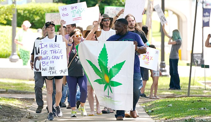 Protesters gathered outside the Mississippi Capitol and Supreme Court to demand that Gov. Tate Reeves call a legislative special session in order to bring back the medical-marijana initiative voters passed last November. Photo by Rogelio V. Solis via AP
