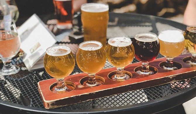 Drinking cold craft beers across Mississippi is one way to get out again. Photo courtesy Tatiana Rodriguez on Unsplash