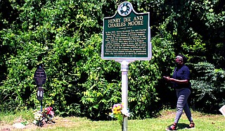 Friends and relatives gathered Thursday in a tiny town in southwestern Mississippi to dedicate a new state historical marker honoring two young Black men who were kidnapped and killed by Ku Klux Klansmen 57 years ago. Photo by Emily Wagster Pettus via Associated Press