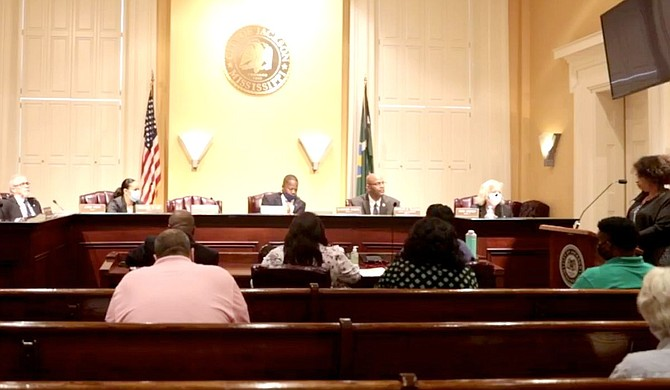 Ruby Holden (standing right) addressed the City Council on June 22, explaining how sewer backing up in her home twice in 2020 left her devastated. Photo courtesy City of Jackson