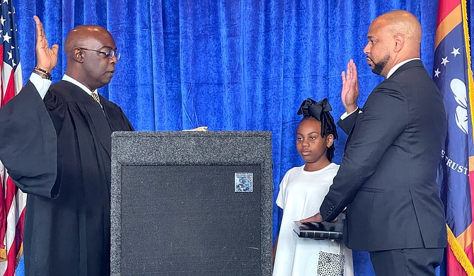 Hinds County Circuit Court Judge Winston Kidd (left) swore in the National Bar Association President Carlos Moore at the Capital Club in Jackson, Miss., on Tuesday, July 27, 2021. Photo by Kayode Crown