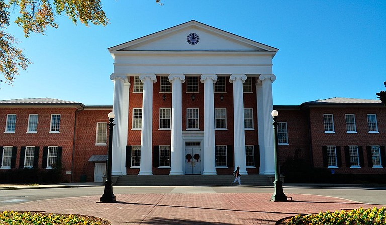 The University of Mississippi has reached a settlement with an assistant professor who was terminated after publicly criticizing the school as racist while speaking out for criminal justice reform. File Photo by Trip Burns