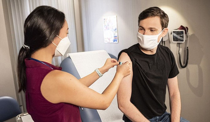 Some Mississippi judges are urging people to follow their example and get vaccinated to slow the spread of COVID-19—an effort aimed at keeping courts open. Photo courtesy CDC on Unsplash