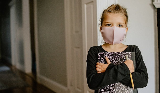 The leader of a Mississippi pediatricians' organization is urging school districts to keep mask mandates in place to slow the spread of COVID-19. Photo courtesy Kelly Sikkema Unsplash
