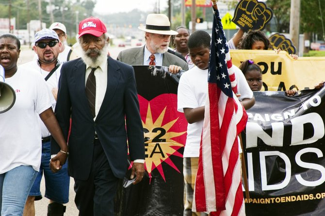 James Meredith holds the hand of Valencia Robinson as she leads the Stand Against AIDS march on Sept 13. The marchers have only 172 miles left to Oxford.