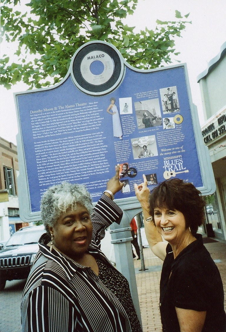 Dorothy Moore tells Peggy Brown about the early days when she was a lead singer of a girl group, The Poppies. Dorothy is sitting atop the post in the top right photo.