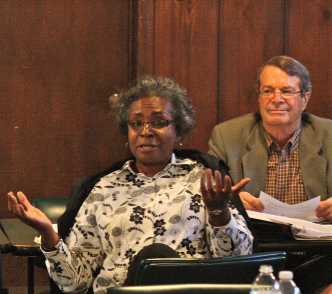 Marva Clark, director of substance abuse services at Hinds Behavioral Health Services, talks to the Fresh Start Task Force Thursday as Michael Raff, Jackson's director of human and cultural services, looks on.