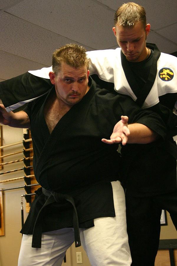 Martial artist Robert Staples (left) demonstrates self-defense techniques in his studio.