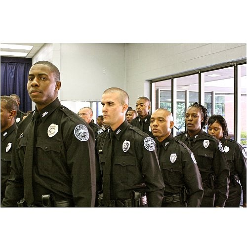 A class of 24 recruits of the Jackson Police Department marches from their seats after taking the oath of office at their graduation on Friday.