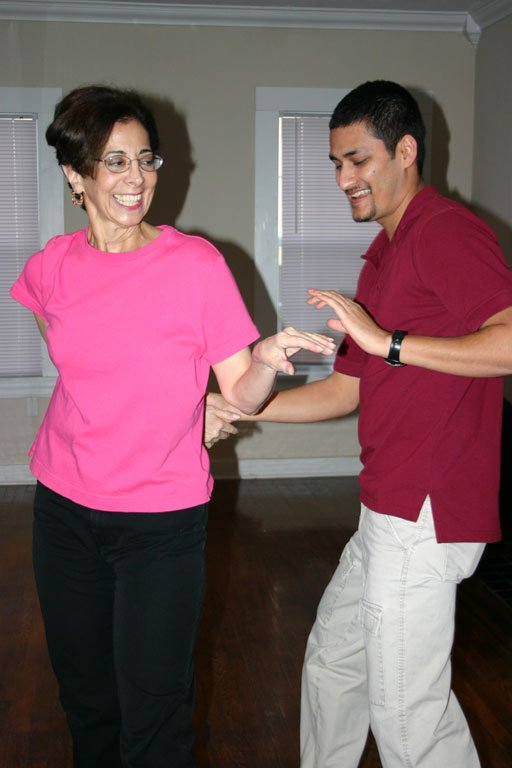 Salsa Mississippi instructor Sujan Ghimire gives a private lesson to one of his students, Joel Escude.