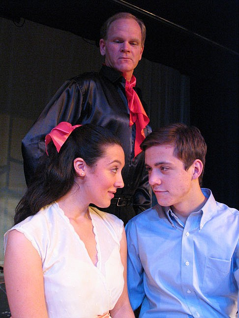 "Ray McFarland (standing), Frances Bordlee (left) and J. Casey Barrett (right) in New Stage Theatre's production of ""The Fantasticks"""