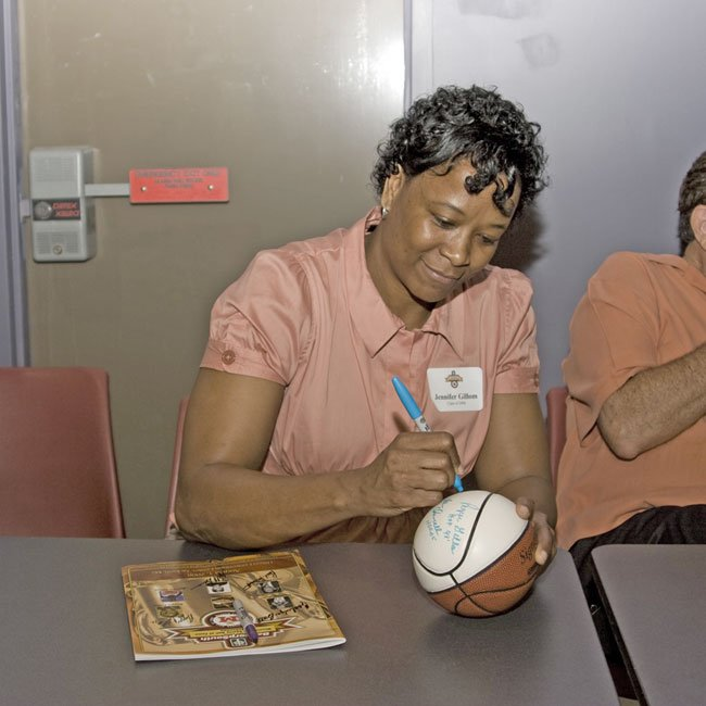 2008 Mississippi Sports Hall of Fame Inductee Jennifer Gillom signs autographs at the Mississippi Sports Hall of Fame and Museum.